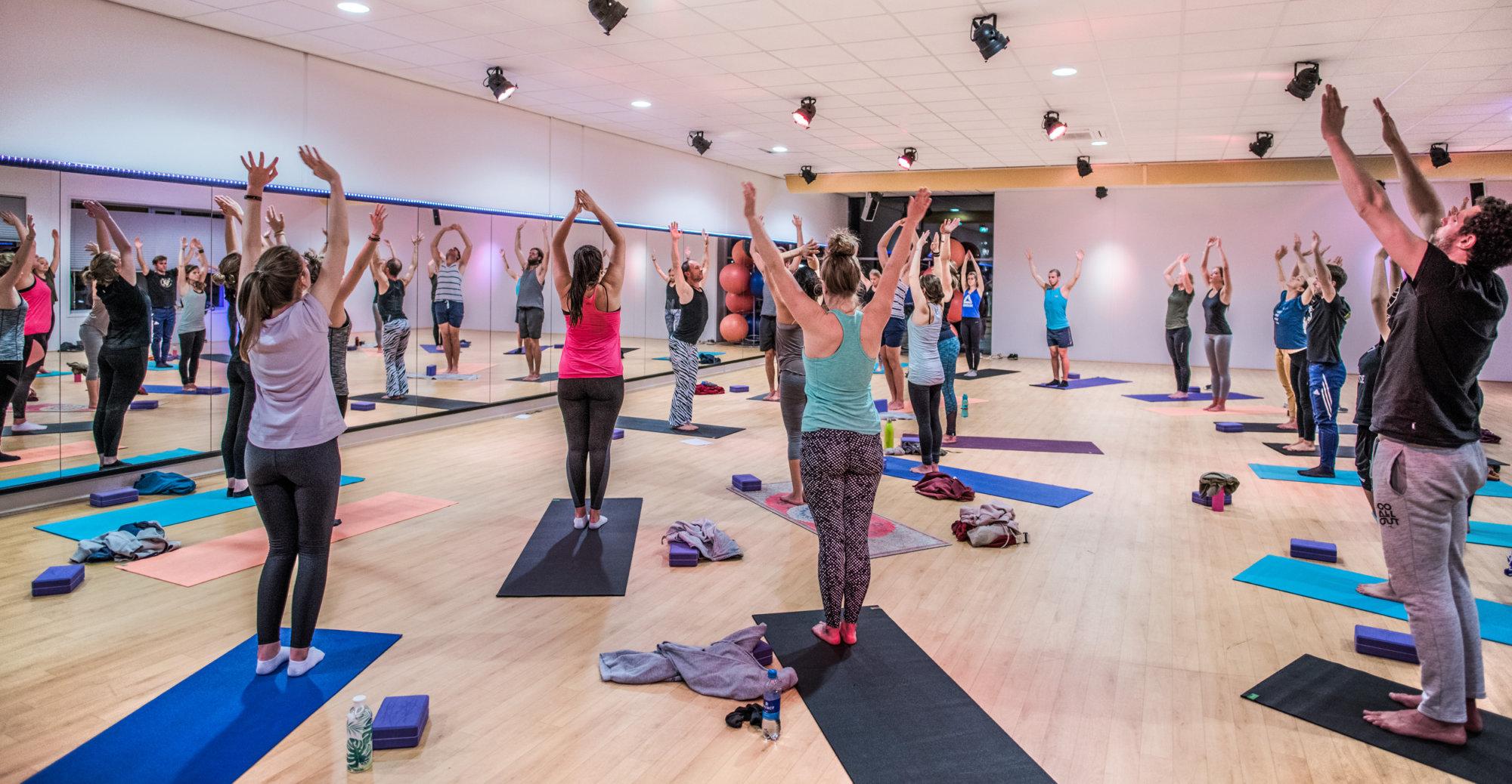 Students Vinyasa class by Bendie Yoga