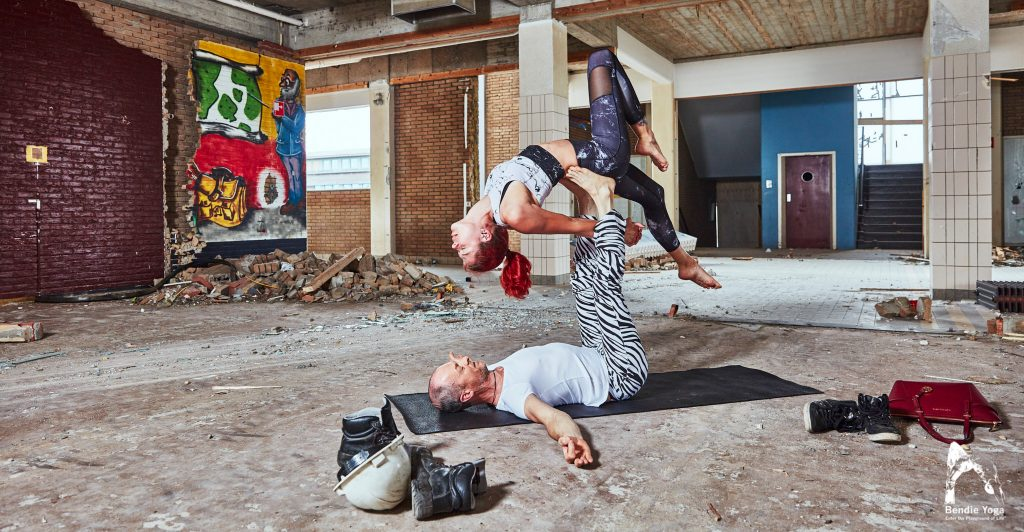 AcroYoga on construction site by Bendie-yoga.com Back bird